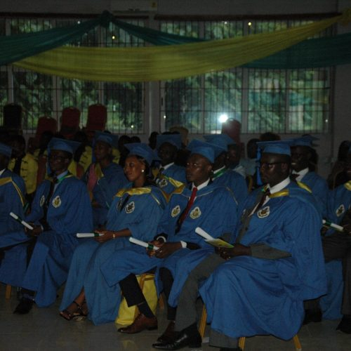 Graduands holding their certs